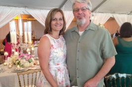 Photo of Wendy and David Jones standing together at a party.