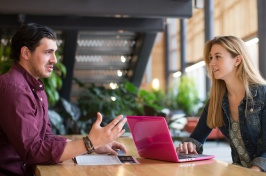 UNH online MBA students studying together