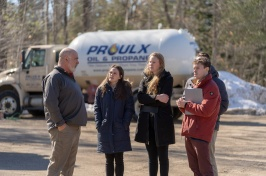 Proulx Oil representative talking with Paul College students in front of Proulx truck