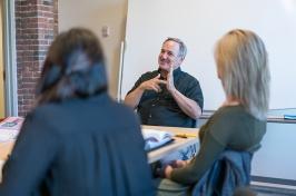 ASL/English Interpreting Professor Jack Hoza signing with students