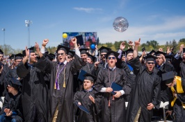 students in caps and gowns