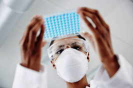 Female scientist works on a vaccine for COVID-19