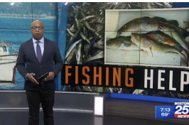 newscaster in front of photo of fish that says fishing help