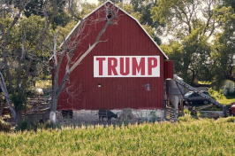 A Trump banner hangs on a barn at a farm in Nebraska in 2018