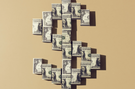 Image of a U.S. currency symbol made from folded up dollars.