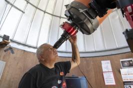 John Gianforte looking through telescope