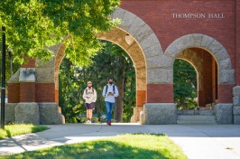 Students walking through T Hall arch