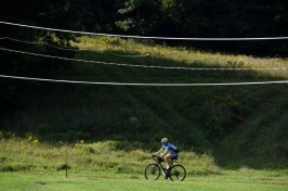 A photograph of a bike rider on trails in the Upper Valley region
