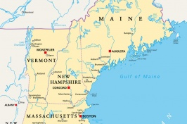 Photo of a map showing the New England states and bordering states and countries.