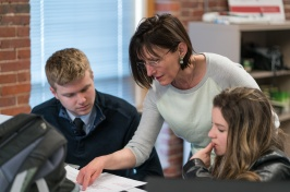 Computer science professor Mihaela Sabin works with UNH Manchester students