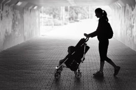Image of Women Walking Baby in a Stroller