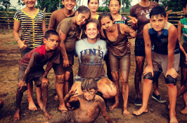 Peace Corps volunteer with community kids