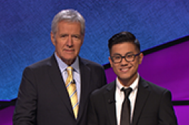 UNH graduate student with Alex Trebek of Jeopardy! game show