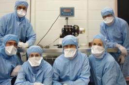 students in medical gowns and masks