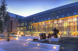 Paul College Building at night
