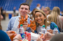 UNH seniors celebrating their impending graduation with classmates over lobster in the rough