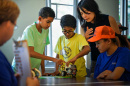 Karen Jin and Brianna Smith lead students through a robotics activity