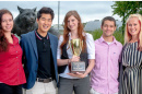pscyhology students with psych cup in front of cat sculpture
