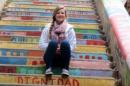 sarah wiggins sitting on colorful steps