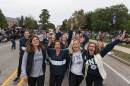 UNH students marching in the Homecoming parade