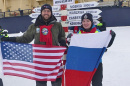 Researchers Kevin Jerram and Evgenia Bazhenova at the North Pole, with American and Russian flags