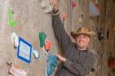 UNH graduate Bill Cudmor on climbing wall