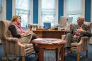 UNH Magazine Editor-in-chief Kristin Waterfield Duisberg talking with President Mark Huddleston