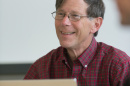 UNH professor David Finkelhor sits in front of  a laptop