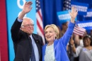Democratic presidential candidate Hillary Clinton and Sen. Bernie Sanders (Vt.) wave after speaking at a rally in Portsmouth, N.H., in July. (Justin Saglio/Agence France-Presse via Getty Images)