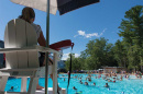 a lifeguard watching people swimming at UNH's new outdoor pool