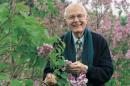 UNH emeritus professor of plant biology Owen Rogers among lilacs