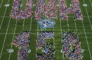 an aerial photo of UNH faculty, staff and students spelling out UNH 150 at Wildcat Stadium