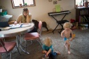 Jasmin Cross trying to study while her sons, Sebastian and Vyvyan, played in their home in Portland, Ore. (Credit Amanda Lucier for The New York Times)