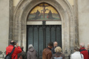 In 2016, visitors stand in front of the cast metal reproduction of Martin Luther's 95 theses in the doorway where in 1517 Luther originally nailed his theses at the Schlosskirche church in Wittenberg, Germany Sean Gallup—Getty Images