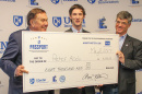 UNH student Peter Abdu '17 receives a check for $8000