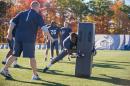 UNH professor Erik Swartz's helmetless football research