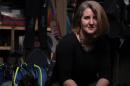 Kristin Duisberg in a closet with some SCUBA gear