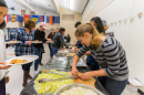 students serving food at international luncheon