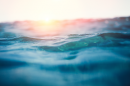 close up of ocean waves with the sun setting