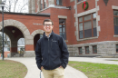 UNH student Jack Hamilton '20 in front of Thompson Hall on the Durham campus