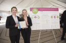 UNH students Kate Aiken and Devin McMahon pose with their prize and research poster for the 2016 Holloway Prize competition entry, LilyPad.