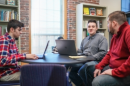UNH Manchester students collaborating on campus newspaper