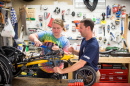 Northeast Passage staff working on an adaptive bicycle