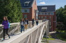 UNH students walking on the new pedestrian bridge connecting Hamilton Smith Hall with Dimond Library