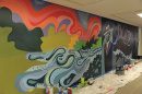 a mural in progress at UNH's Dimond Library, celebrating its sesquicentennial