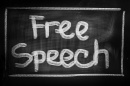 "A sign that reads ""Free Speech"""