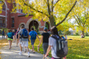 UNH students walking by Thompson Hall