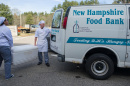 UNH-grown fish in a cooler being handed to the NH Food Bank