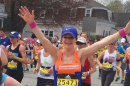 UNH student and runner Katie Litwinowich Meinelt '03, '04G crossing the finish line at the Boston Marathon