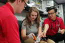 UNH's Adam Huynh working with others as an EMT